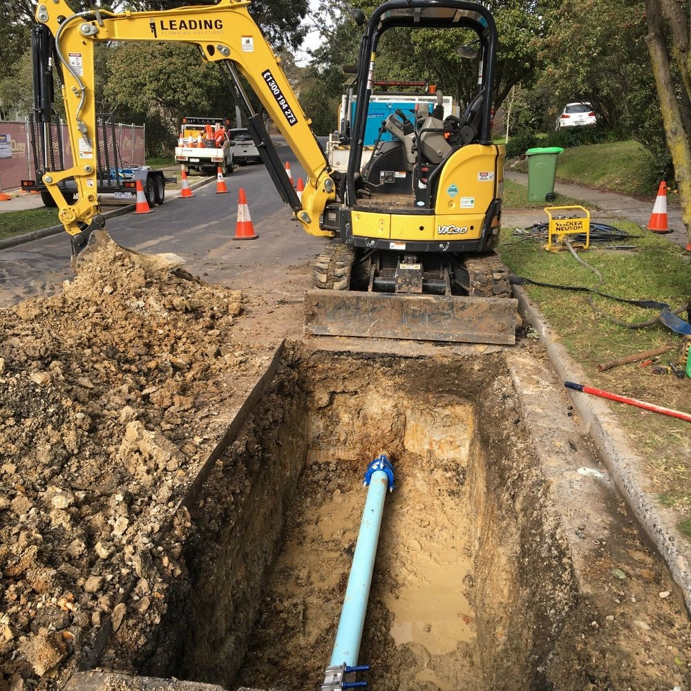 civil plumber melbourne - back hoe